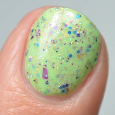 green nail polish with glitter close up swatch