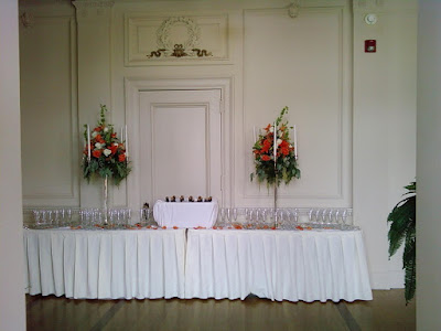 A pair of cendelabras for the champagne table with floral arrangements by Stein Your Florist Co.