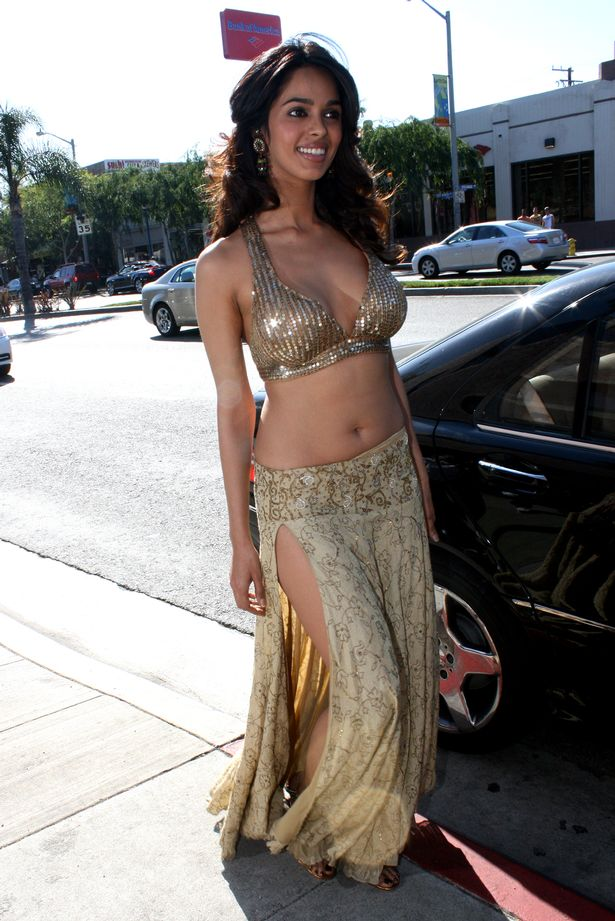 India-movie-star-and-sex-symbol-Mallika-Sherawat-makes-her-own-milkshake-and-teases-photographers-in