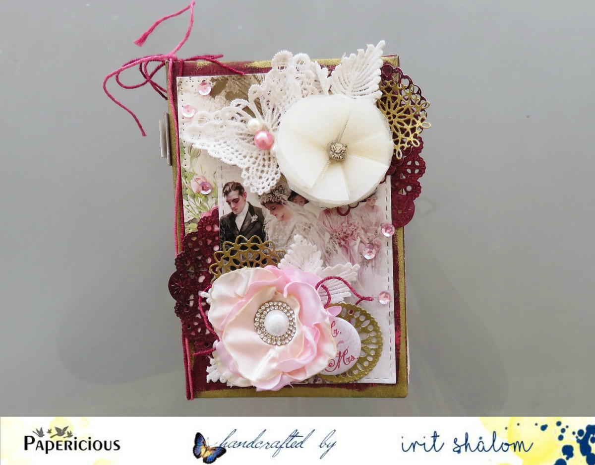 The doilies, fabric flowers, leaves, butterflies and twine were ...
