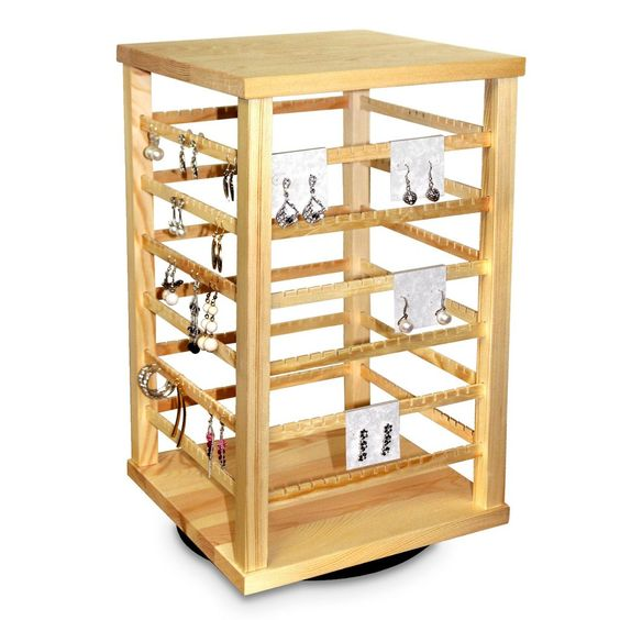 A wooden jewelry display stand for earrings.