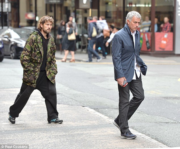 Jose Mourinho found himself being followed by people in Manchester city centre after he was spotted appearing to hand out cash.