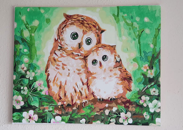 Completed paint by numbers canvas print of owls