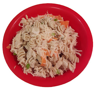 A cold pasta and tuna salad with carrots and green onion, using Aldi's pasta.
