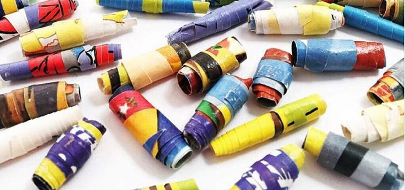 Make DIY paper beads from kids old artwork