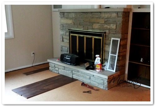 Love the laminate by the fireplace