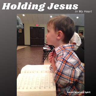 And a Child Shall Lead Them - Holding Jesus