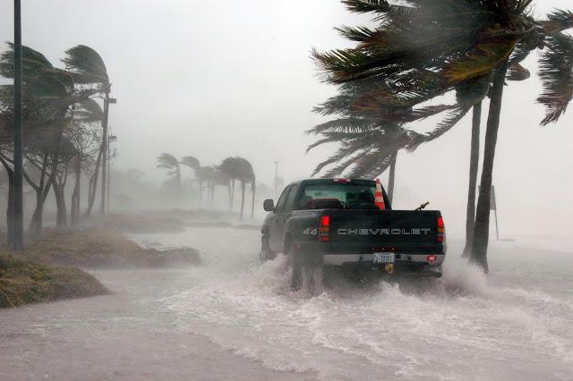 Man Driving a Car Through The Intense Storm.