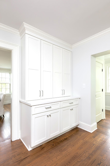 built in cabinets tall doors transitional white remodel polished chrome hardware pulls
