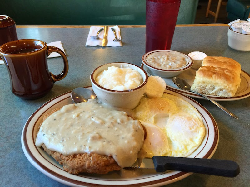 Country fried steak, eggs, grits, biscuits, and gravy at Omar's Hi-Way Chef in Tucson