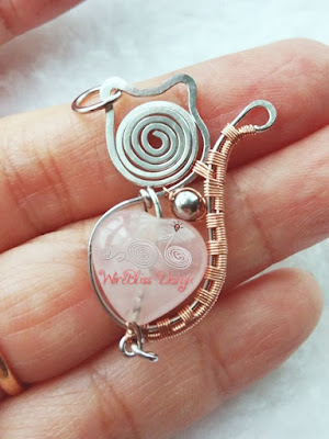 Wire wrapped cat pendant with rose quartz and stainless steel metal bead