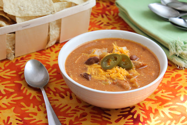 Food Lust People Love: This slow cooker cheesy chicken enchilada soup has all the wonderful flavors of your favorite enchilada dish in a warming bowl.