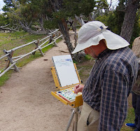 Painter with easel in Yellowstone National Park painting natural beauty