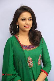 Actress Sri Divya Pictures in Green Salwar Kameez at Rayudu Team Meet 0051