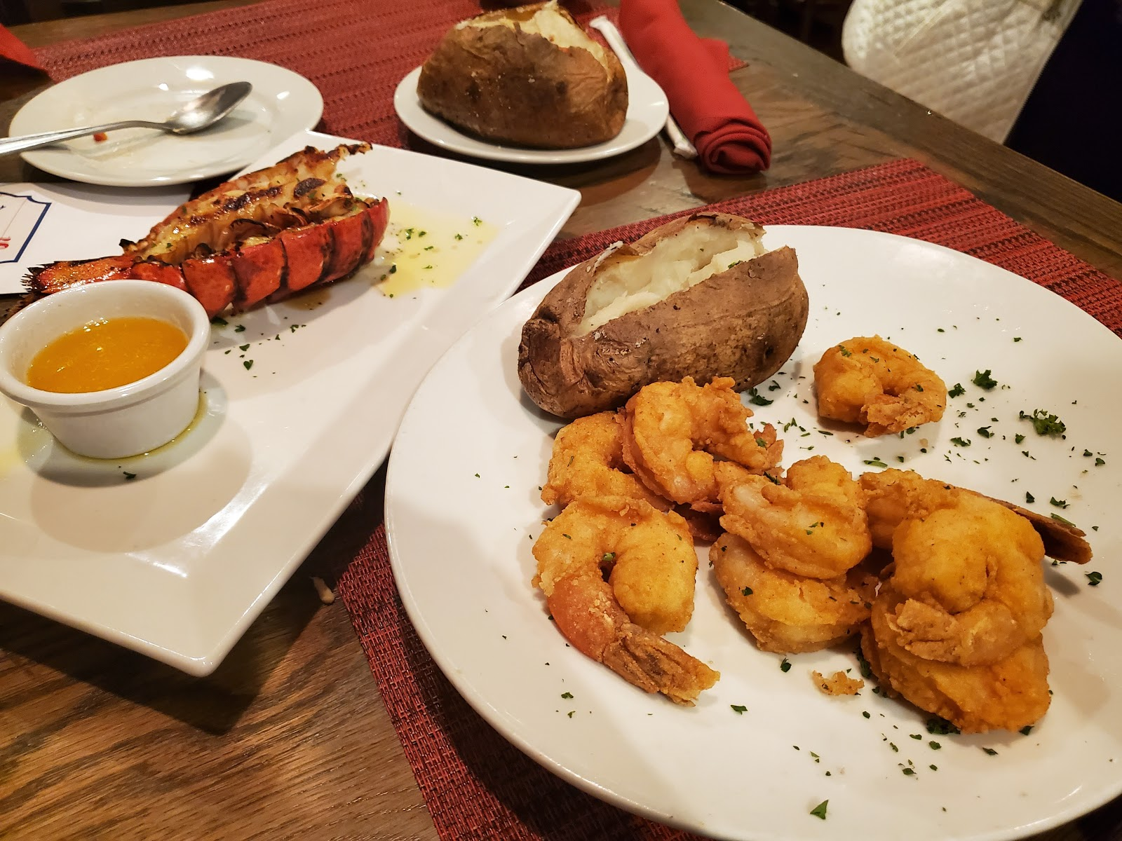 Shrimp, lobster tail, and baked potato