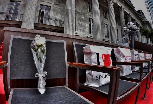 3.15PM: Mr Lee Kuan Yew's seat at the Padang left empty and flowers placed on it, as a tribute to his contributions to Singapore.