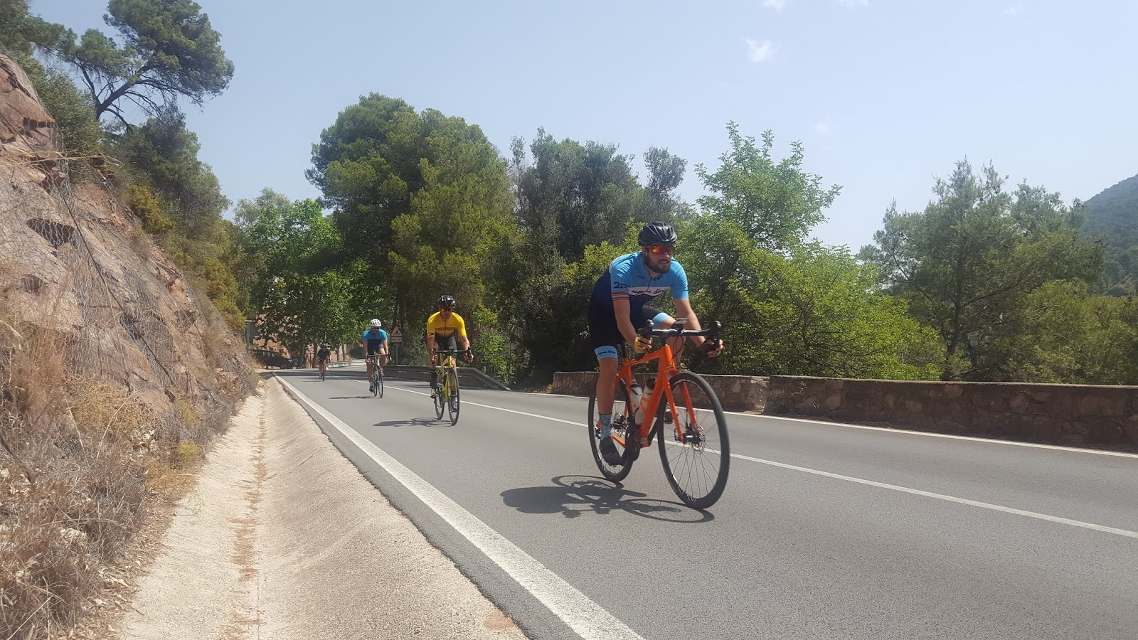 Group of cyclists descending l'Oronet, Valencia, Spain