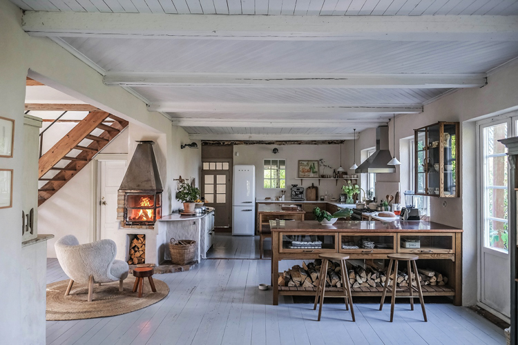 Oak and a Cosy Roaring Fire In A Swedish Cottage Kitchen