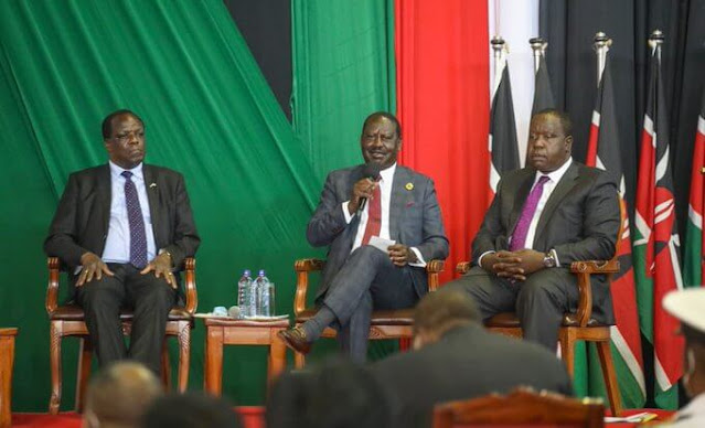 Raila Odinga with others at KICC