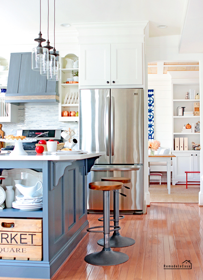 white and grey kitchen makeover with blue and red touches