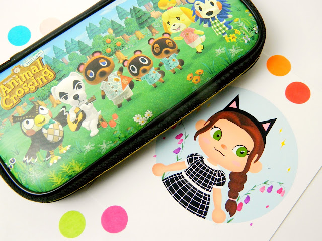 A photo showing an Animal Crossing New Horizons themed Nintendo Switch case, as well as an art piece showing an Animal Crossing character portrait