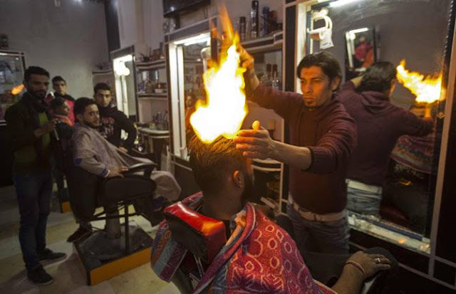 Palestinian barber uses fire to style hair