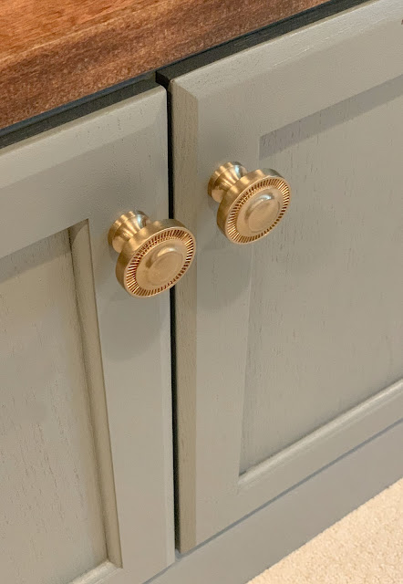 brass knobs on gray cabinets