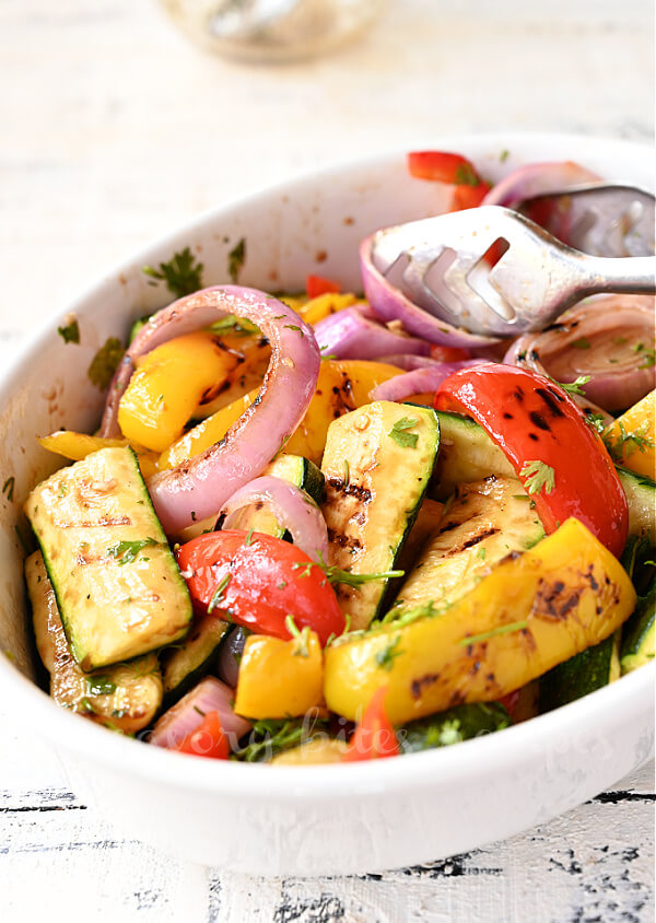 a closer look of white bowl with balsamic grilled vegetables
