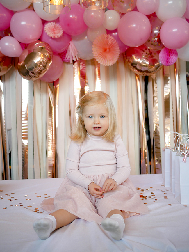 Blush pink and gold party backdrop for a girl's birthday party