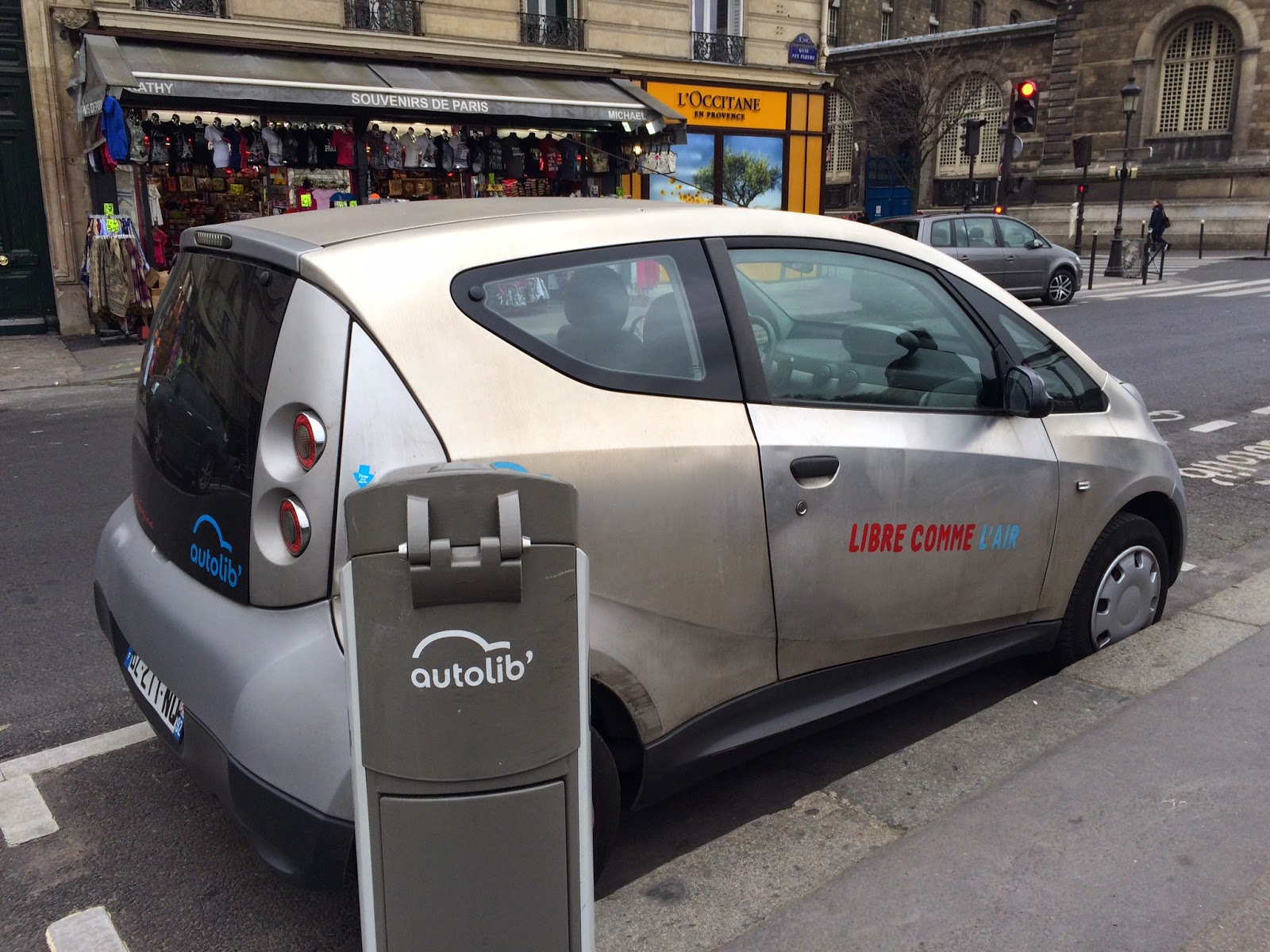 Pic of electric car recharging in Paris street