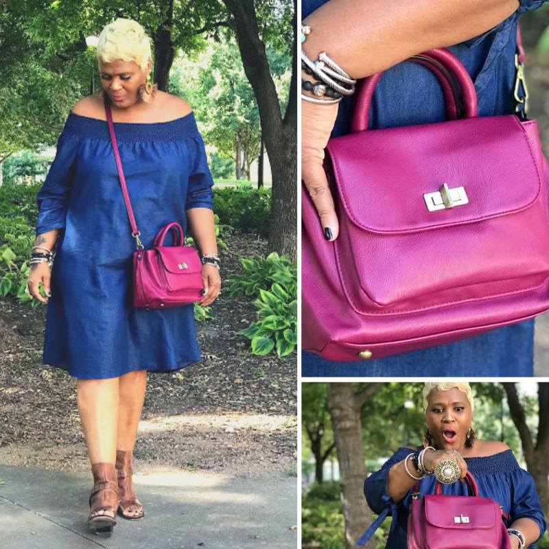 Image: Woman Tangie Bell showing her new thrift find at the store. Crossbody handbag