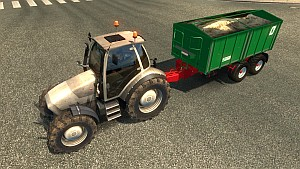 Tractor with trailer in traffic