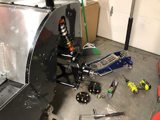 Hub carrier and brake caliper bracket installed.