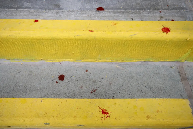 Some reporters also recorded the image of blood stains on the stands.
