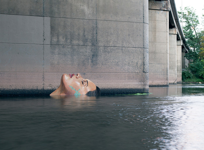 b129f43ab5 Murals of Women Emerging from the Water by Sean Yoro