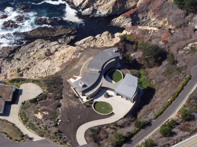 Aerial picture of otter cove residence built on the cliffs above the ocean