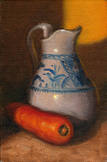 Oil painting of a blue and white porcelain jug beside an orange carrot.