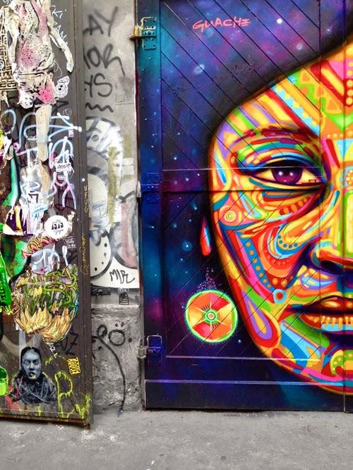 Graffiti Street-Art urbane Kunst eingeborene Frau Indianerfrau Latina afrikanische Frau große Ohrringe schöne Straßenkunst