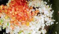 Frying onion, tomato for egg bhurji recipe