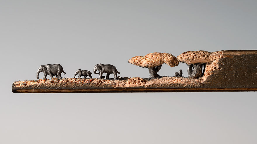 I Carved A Family Of Elephants Into A Pencil - I scored the wood of the pencil to create the look of grass