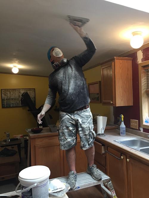 sanding the ceiling