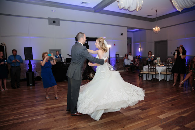 first dance at Noah's Event Venue in Auburn Hills Michigan with dress twirling