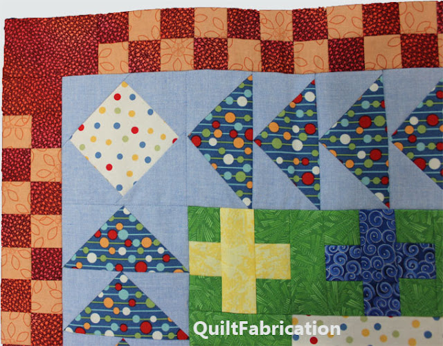 red and orange checkerboard quilt border