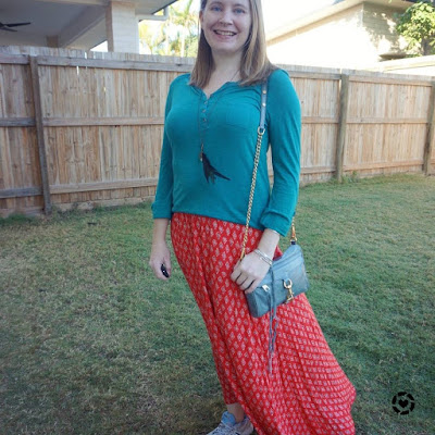 awayfromtheblue Instagram | teal henley and red printed maxi skirt outfit with blue mini mac bag autumn school run style