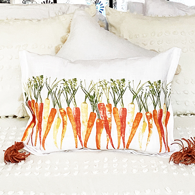 carrot pillow on a bed