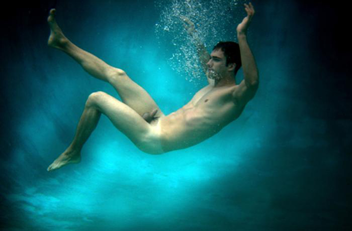 Naked blond male swimmer