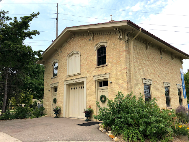The charming brick stable is a focal point of new history being made.