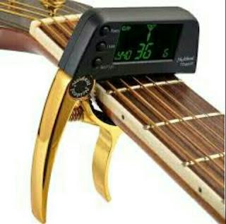 Kamu Seorang Gitaris? Ketahui Fungsi Capo Gitar Berikut Ini