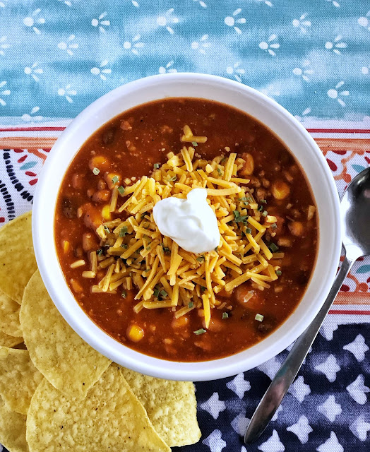 taco soup with cheese and sour cream