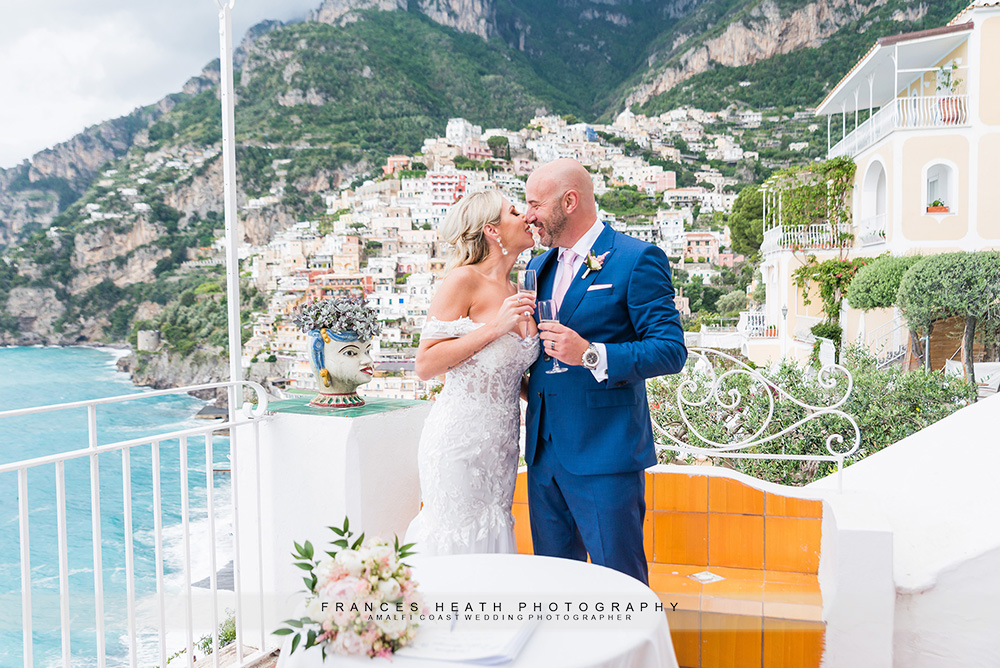 Champagne toast after ceremony with Positano view